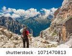female trekker walking along... | Shutterstock . vector #1071470813