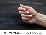 the manicure  pink with white... | Shutterstock . vector #1071473228
