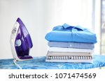 stack of clean clothes and... | Shutterstock . vector #1071474569