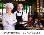 portrait of frendly waiter and... | Shutterstock . vector #1071478166