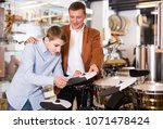 positive  teenager and father... | Shutterstock . vector #1071478424