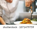 unrecognizable male chef... | Shutterstock . vector #1071479759