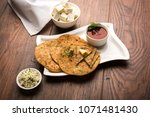 stuffed paneer paratha with... | Shutterstock . vector #1071481430