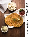 stuffed paneer paratha with... | Shutterstock . vector #1071481433