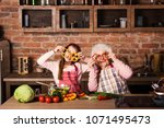 grandchild with granny holding... | Shutterstock . vector #1071495473