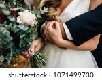 the bridegroom embraces the... | Shutterstock . vector #1071499730