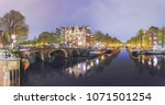 canals of amsterdam. moody... | Shutterstock . vector #1071501254