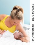 beautiful  young mother with... | Shutterstock . vector #1071504368