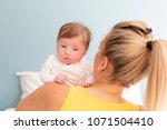 beautiful  young mother with... | Shutterstock . vector #1071504410