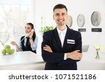 portrait of male receptionist... | Shutterstock . vector #1071521186