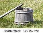 ancient wooden tub with a yoke | Shutterstock . vector #107152790