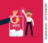 businessman vote at ballot box. ... | Shutterstock .eps vector #1071528050