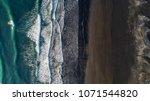 the black sand beach in iceland.... | Shutterstock . vector #1071544820