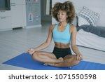 fit ethnic woman in sportswear...   Shutterstock . vector #1071550598