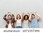 photo of happy group of friends ... | Shutterstock . vector #1071557390
