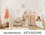 plush bear on white cupboard in ... | Shutterstock . vector #1071565190