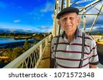 elderly 80 plus year old man... | Shutterstock . vector #1071572348