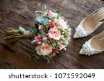 bridal flower and bridal shoes | Shutterstock . vector #1071592049
