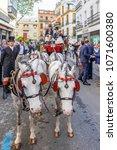 Small photo of Seville, Spain - April 15, 2018: Pony drawn carriage, driven by kids in Seville April Fair (Feria de Abril de Sevilla)