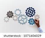 hand with support gears... | Shutterstock . vector #1071606029