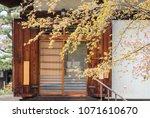 japnanese old house behind tree ... | Shutterstock . vector #1071610670