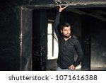 young bearded handsome guy in... | Shutterstock . vector #1071616388