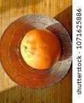 orange on the table   Shutterstock . vector #1071625886