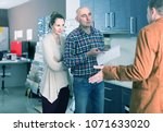 angry european couple makes... | Shutterstock . vector #1071633020