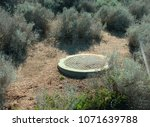 Small photo of Trap door of old bunker in the middle of the desert