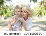 mother and toddler daughter in... | Shutterstock . vector #1071650990