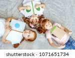 three children of students read ... | Shutterstock . vector #1071651734