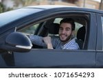 young man sitting in his car... | Shutterstock . vector #1071654293