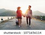 couple tourism backpack walking ... | Shutterstock . vector #1071656114