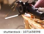 sparks during cutting of metal... | Shutterstock . vector #1071658598