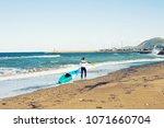 man carrying kayak at sea beach | Shutterstock . vector #1071660704