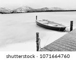 Frozen Lake With Boat And...
