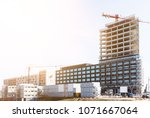 construction site with cranes... | Shutterstock . vector #1071667064
