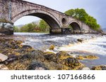 ancient bridge over a fast... | Shutterstock . vector #107166866
