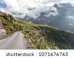 zigzags of the road from manali ... | Shutterstock . vector #1071676763