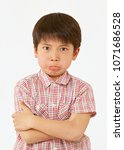 asian boy crossing one's arms... | Shutterstock . vector #1071686528