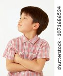 asian boy crossing one's arms... | Shutterstock . vector #1071686534