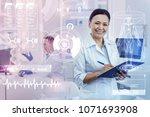 cheerful doctor. kind... | Shutterstock . vector #1071693908