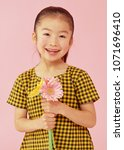 the asian girl with flowers in... | Shutterstock . vector #1071696410