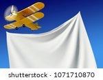 yellow biplane flying in the... | Shutterstock . vector #1071710870