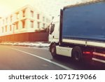 fast truck on a city road... | Shutterstock . vector #1071719066