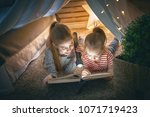 two cute little children are... | Shutterstock . vector #1071719423