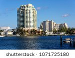 boats and high rise buildings... | Shutterstock . vector #1071725180