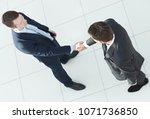 in full growth.handshake ... | Shutterstock . vector #1071736850