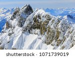 wintertime view from mt. titlis ... | Shutterstock . vector #1071739019
