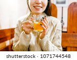 woman drinking tea with lemon... | Shutterstock . vector #1071744548